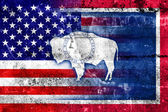 USA and Wyoming State Flag painted on grunge wall — Stock Photo