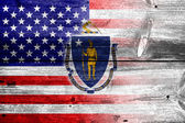 USA and Massachusetts State Flag painted on old wood plank texture — Stock Photo