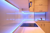Modern luxury kitchen with purple LED lighting — Stock Photo