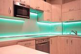 Modern luxury kitchen with green LED lighting — Stock Photo