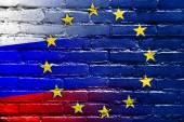 Russia and European Union Flag painted on brick wall — Stock Photo