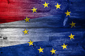 Netherlands and European Union Flag painted on old wood plank texture — Stock Photo