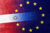 Latvia and European Union Flag painted on leather texture — Stock Photo