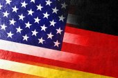 USA and Germany Flag painted on leather texture — Stock Photo