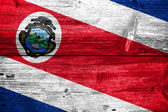 Costa Rica Flag painted on old wood plank background — Stock Photo