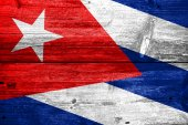 Cuba Flag painted on old wood plank texture — Stock Photo