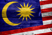 Malaysia Flag painted on old wood plank texture — Stock Photo