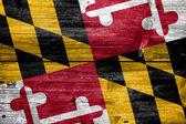 古い木の板テクスチャに描かれたメリーランドの州の旗 — ストック写真