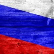 Russia flag painted on old wood plank background — Stock Photo #60032549