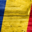 Romania Flag painted on old wood plank background — Stock Photo #60032557