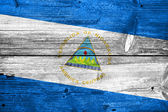 Nicaragua Flag painted on old wood plank texture — Stock Photo