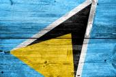 флаг сент-люсия, окрашены на старый текстуру древесины доски — Стоковое фото