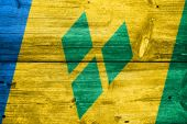 Saint Vincent and The Grenadines Flag painted on old wood plank texture — Stock Photo