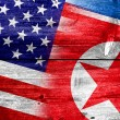 USA and North Korea Flag painted on old wood plank texture — Stok fotoğraf #60068575
