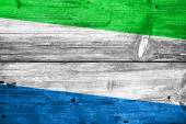 Sierra Leone Flag painted on old wood plank background — Stock Photo