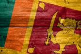 Sri Lanka Flag painted on old wood plank texture — Stock Photo