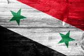 Syria Flag painted on old wood plank background — Stock Photo