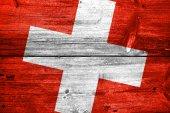 Switzerland Flag painted on old wood plank background — Stock Photo