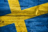Sweden Flag painted on old wood plank background — Stock Photo