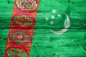 Turkmenistan Flag painted on old wood plank texture — Stock Photo
