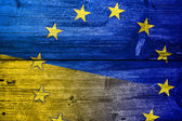 Ukraine and EU Flag painted on old wood plank texture — Stock Photo