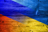 Ukraine and Russia Flag painted on old wood plank texture — Stock Photo