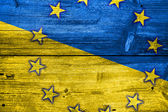 Ukraine and EU Flag painted on old wood plank texture — Stockfoto