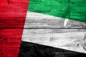 United Arab Emirates Flag painted on old wood plank background — Stock Photo
