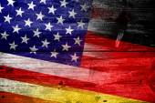USA and Germany Flag painted on old wood plank texture — Stock Photo