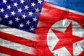 USA and North Korea Flag painted on old wood plank texture — Stockfoto