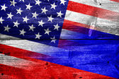 USA and Russia Flag painted on old wood plank texture — Stock Photo