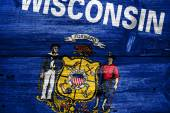 Wisconsin State Flag painted on old wood plank texture — Stock Photo