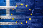 Greece and European Union Flag painted on old wood plank texture — Stock Photo