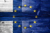 Finland and European Union Flag painted on old wood plank texture — Stock Photo