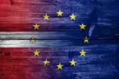 Latvia and European Union Flag painted on old wood plank texture — Stock Photo