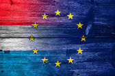Luxembourg and European Union Flag painted on old wood plank texture — Stock Photo