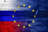 Russia and European Union Flag painted on old wood plank texture — Stock Photo