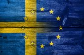 Sweden and European Union Flag painted on old wood plank texture — Stock Photo