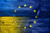 Ukraine and European Union Flag painted on old wood plank texture — Stock Photo