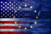 United States and European Union Flag painted on old wood plank texture — Foto de Stock