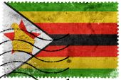 Zimbabwe Flag - old postage stamp — Stock fotografie