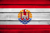 French Polynesia Flag on wood background — Stock Photo