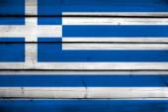 Greece Flag on wood background — Stock Photo