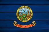 Idaho State Flag on wood background — Stock Photo