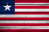 Liberia Flag on wood background — Stock Photo