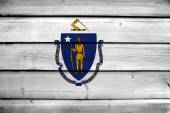 Massachusetts State Flag on wood background — Stock Photo