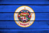 Minnesota State Flag on wood background — Stock Photo