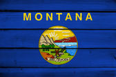 Montana State Flag on wood background — Stock Photo