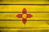 New Mexico State Flag on wood background — Stock Photo