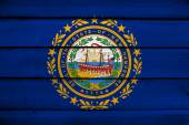 New Hampshire State Flag on wood background — Stock Photo